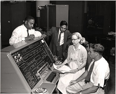A picture of Grace Hopper with COBOL team members and UNIVAC I