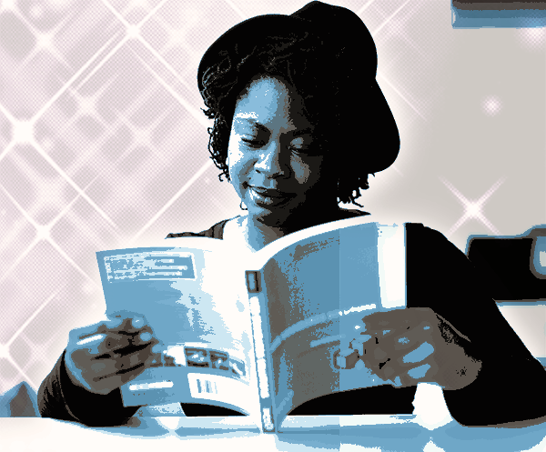 woman reading a technical book